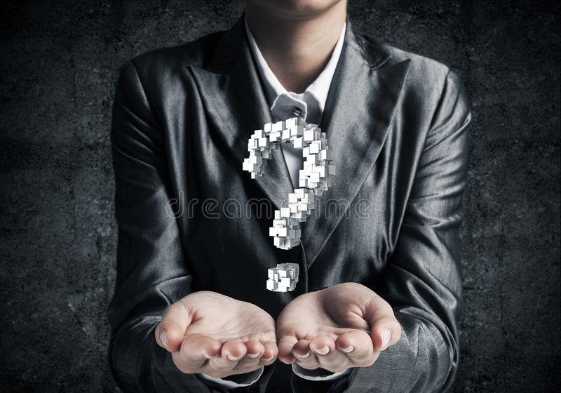 Businessman presenting question mark. Cropped image of businessman in suit presenting multiple cubes in form of question mark in his hands. 3D rendering stock photo