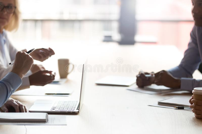 Cropped image businesspeople sitting at table discussing making decisions stock images