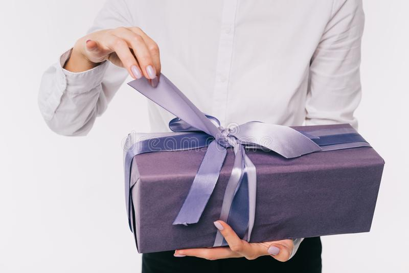 cropped image of businesswoman opening present box stock photo