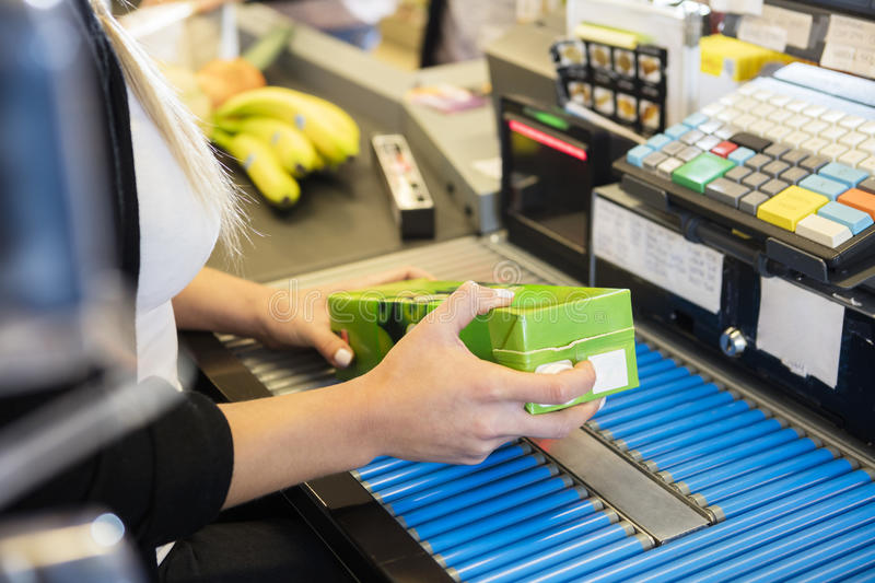 Cropped Image Of Cashier Scanning Juice Pack`s Barcode. Cropped image of female cashier scanning juice pack`s barcode in supermarket stock images