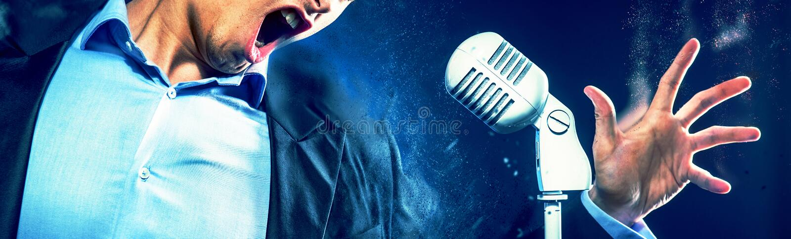 Cropped image caucasian expressive man open mouth singing on vintage white microphone. Image with digital effects stock photo