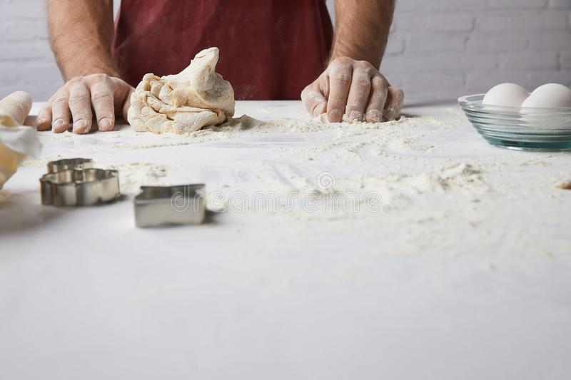 Chef standing at table with dough. Cropped image of chef standing at table with dough royalty free stock photos