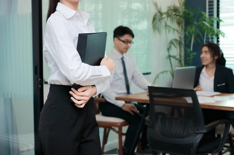 Cropped image of confident young Asian businesswoman standing in modern office. Leadership business woman concept royalty free stock photography