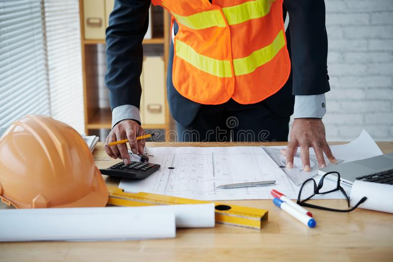 Engineer checking blueprint stock images