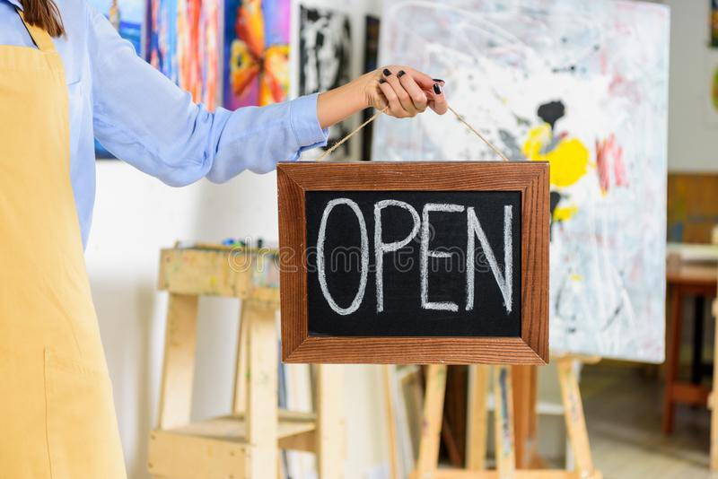 cropped image of female artist holding signboard with word open royalty free stock photos