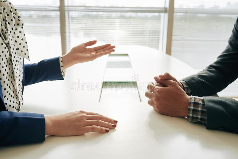 Discussion. Cropped image of female entrepreneur having talk with her coworker royalty free stock photos