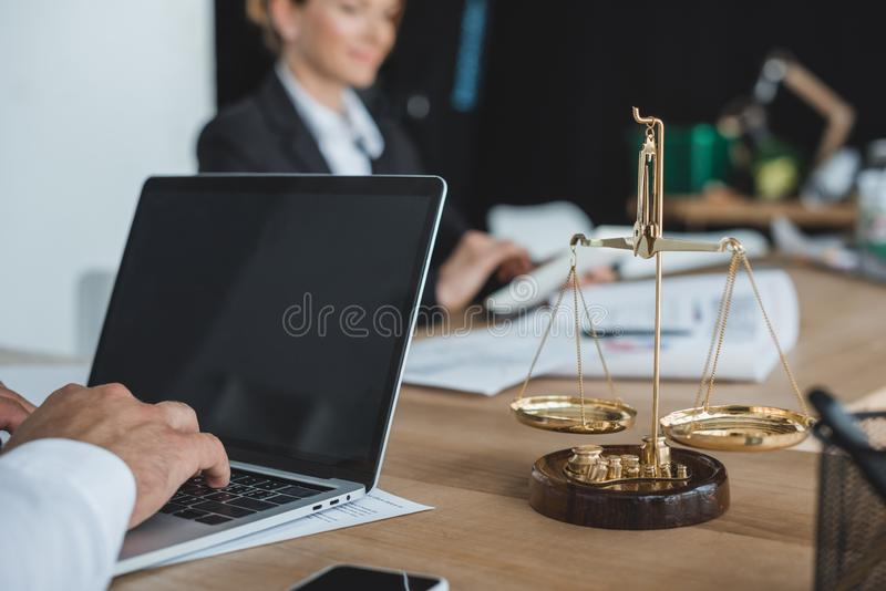 Cropped image of financier working with laptop at table. In office royalty free stock photos