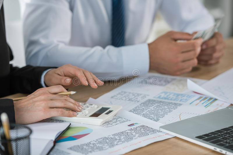 Cropped image of financiers counting money together. In office royalty free stock photos