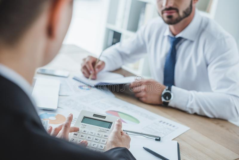Cropped image of financiers working at table. In office royalty free stock images