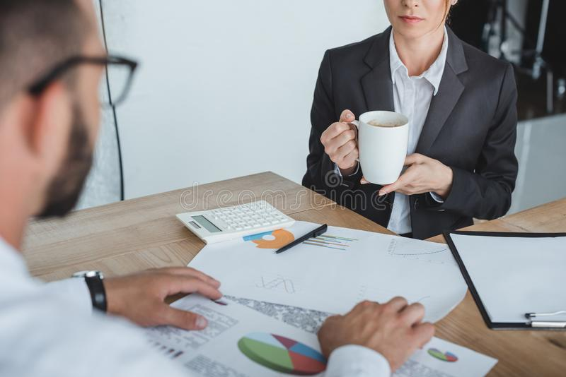 Cropped image of financiers working at table. In office stock photos