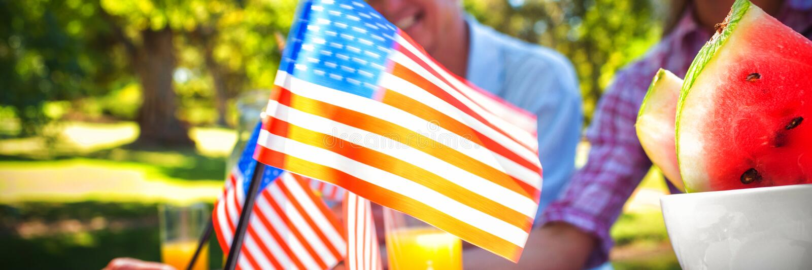 Cropped image of hand holding American flag stock photography