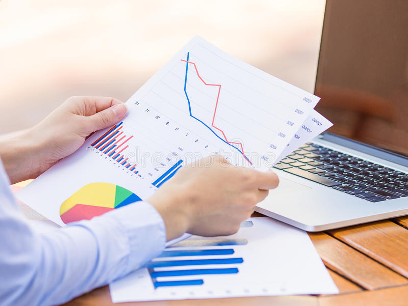 Cropped image hands with financial charts papers stock photo