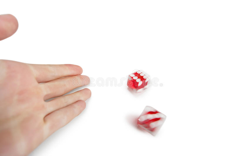 Cropped image of hands throwing gambling dice over white background royalty free stock images