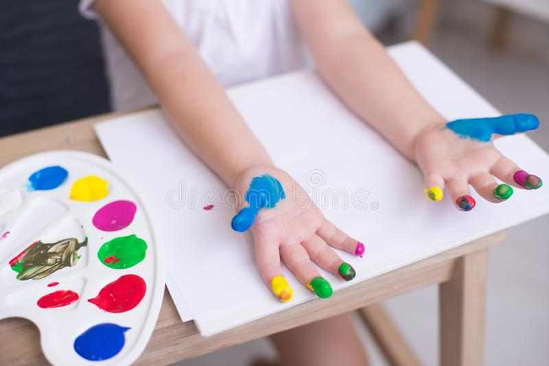 Cropped image of little girl playing with paints stock photography