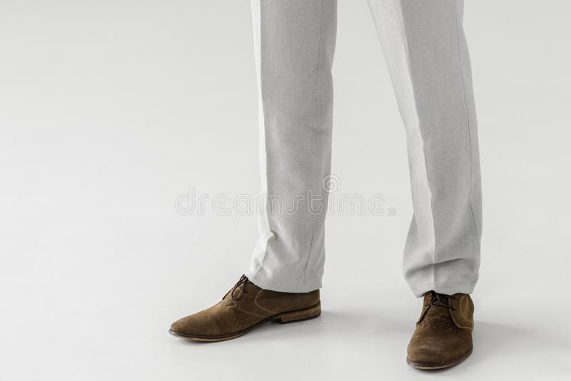 cropped image of male model in linen trousers and suede shoes stock images