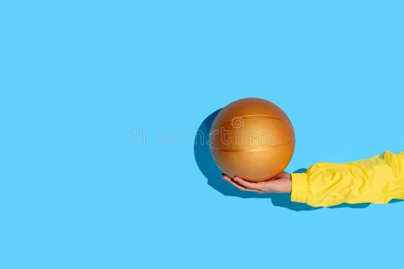 Cropped image of man hand with basketball ball. In hand stock image