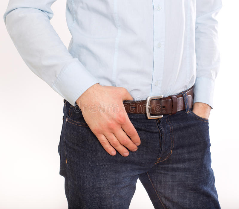 Cropped image of man in jeans stock image