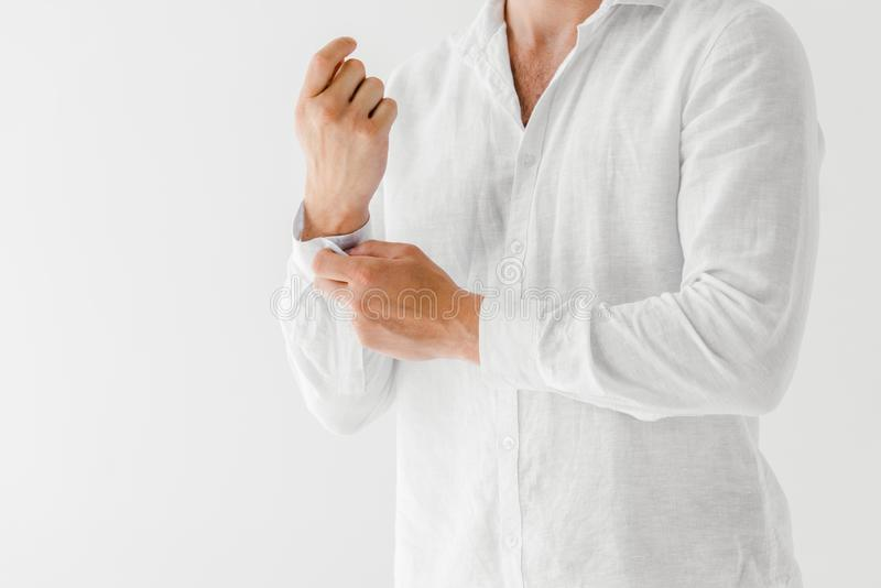 Cropped image of man in linen white shirt. Isolated on grey background royalty free stock photos