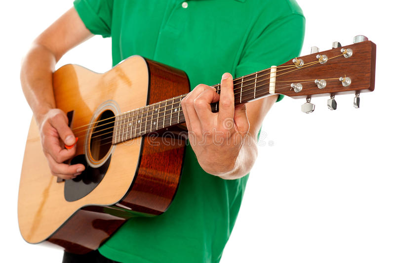 Download Cropped Image Of A Man Playing Guitar Stock Photo - Image of culture, close: 25883698