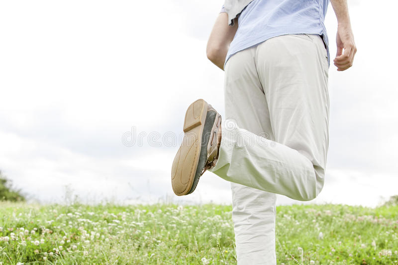 Download Cropped Image Of Man Running In Park Against Sky Stock Photo - Image: 41406044