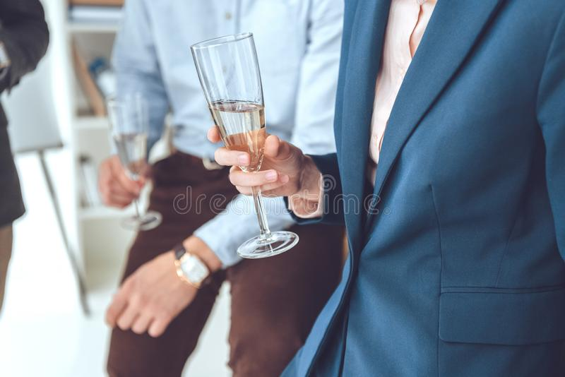 cropped image of men holding glasses stock photography