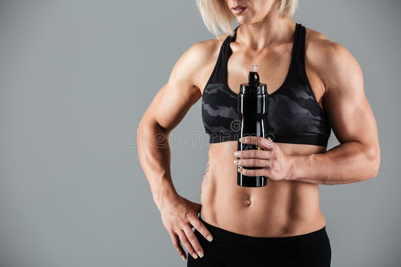 Cropped image of a muscular adult woman stock images