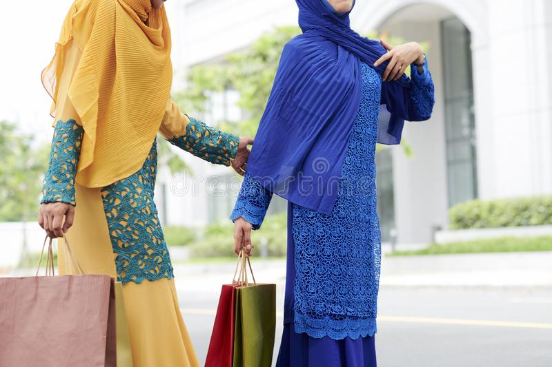 Muslim women with shopping bags stock photo