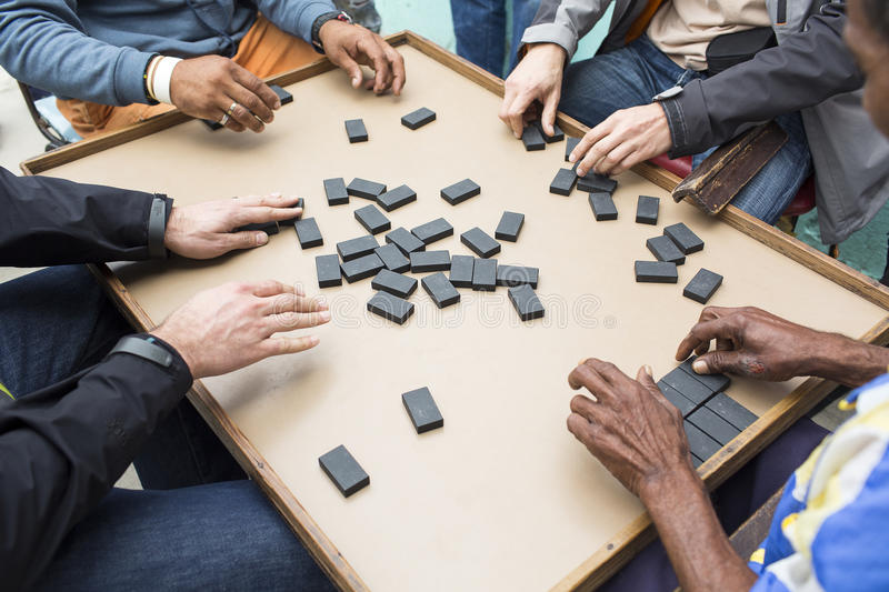Cropped image of people playing domino on street royalty free stock images