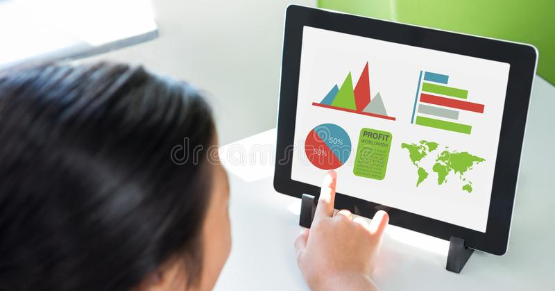 Cropped image of person using digital tablet with various graphs and charts on screen at table. Digital composite of Cropped image of person using digital tablet royalty free illustration