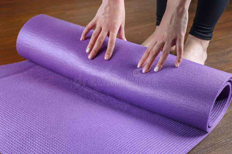 Cropped image of rolling yoga mat royalty free stock image