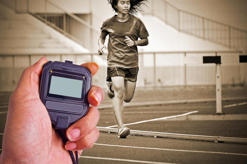 Cropped image of runner on competitive running stock image