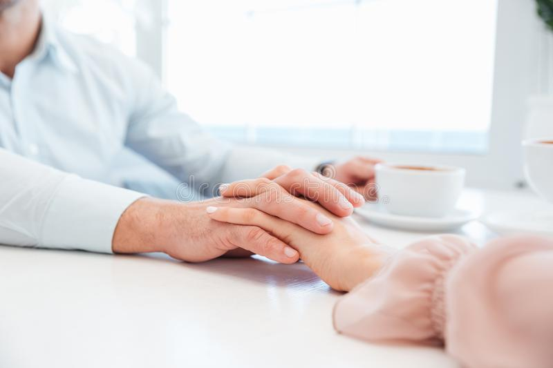 Cropped image of sensual lovely couple holding hand each other stock image