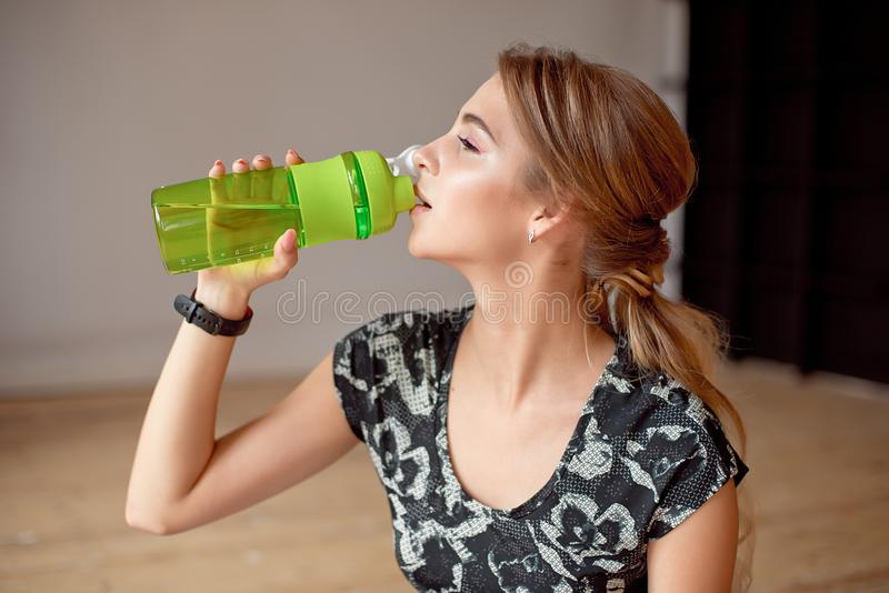 Cropped image of sporty woman holding bottle of water. Cropped image of sporty woman holding bottle of water stock photography