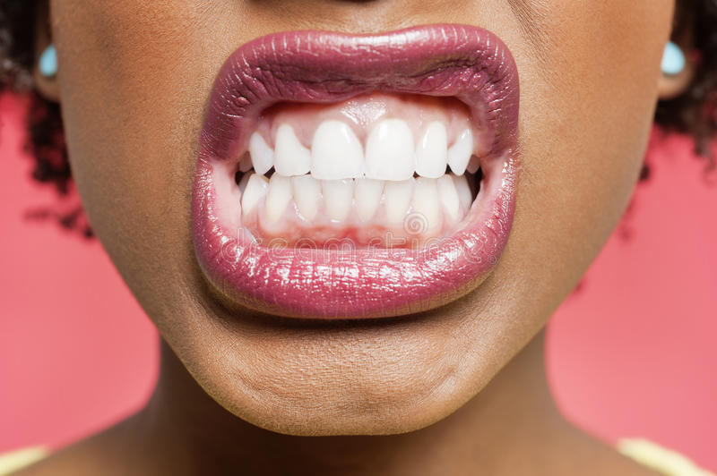 Download Cropped Image Of Woman Clenching Teeth Stock Photo - Image: 29673432