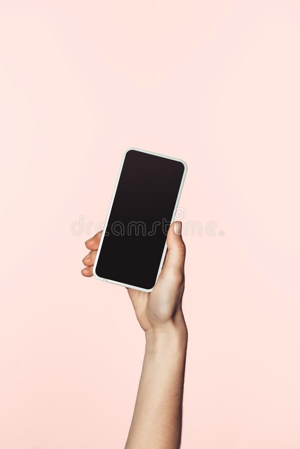 cropped image of woman holding smartphone with blank screen stock image