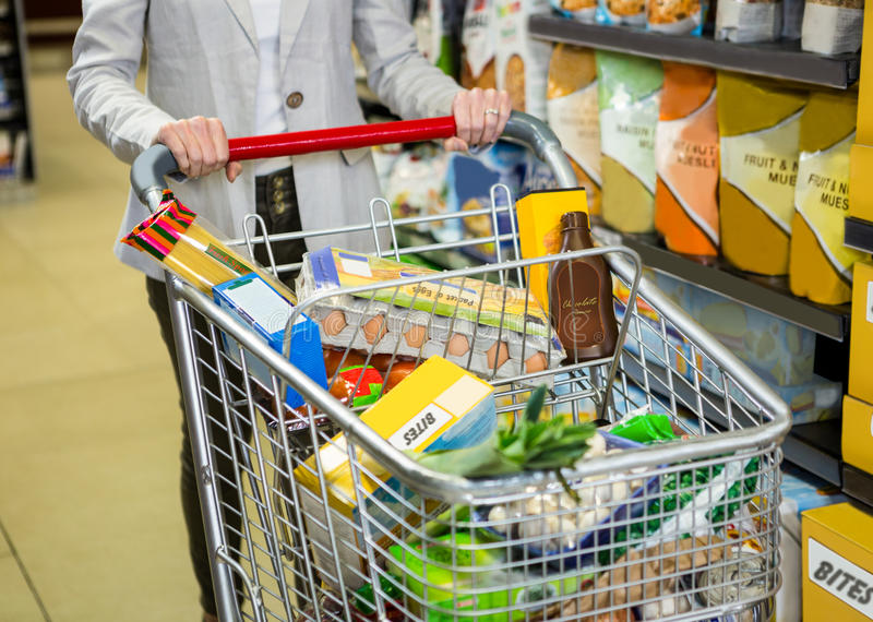 Cropped image of woman pushing trolley stock photo