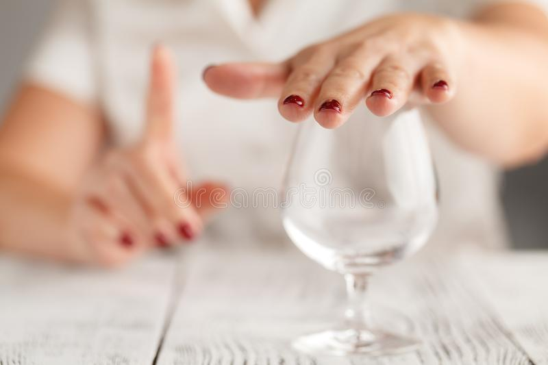 Cropped image of woman showing stop gesture and refusing to drink royalty free stock photos