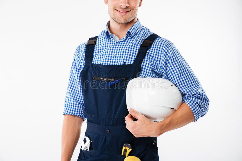 Cropped image of a worker holding helmet stock photo