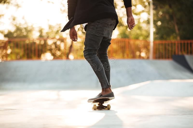 Cropped image of a young teenage skateboarder in action stock image