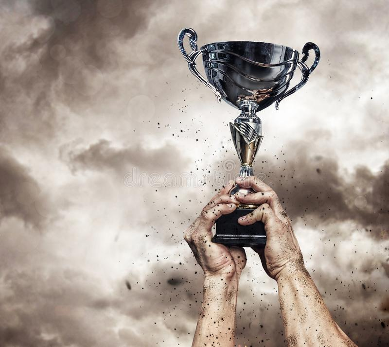 Cropped male arms with winner cup. stock photos