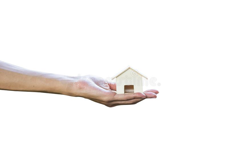 Cropped of man hand holding or giving Small house isolated on white background royalty free stock images