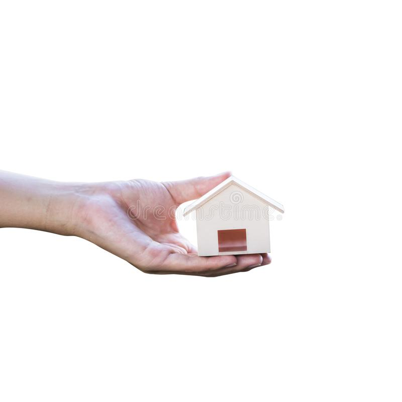 Cropped on a man hand holding small wood house isolated on white background.  stock photo