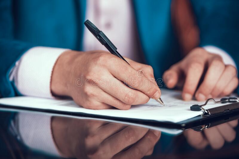 Cropped Photo of Man in Suit Putting Signature. stock photos