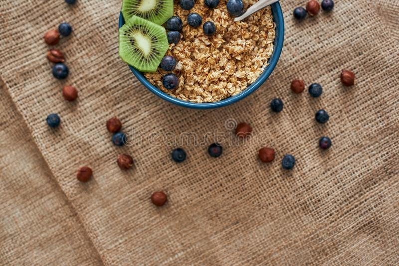 Cropped photo of muesli bowl with fruits. Healthy snack or breakfast in the morning. stock images