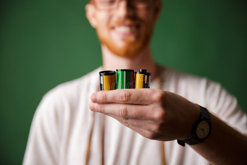 Cropped photo of readhead bearded photographer, holding camera r stock photos