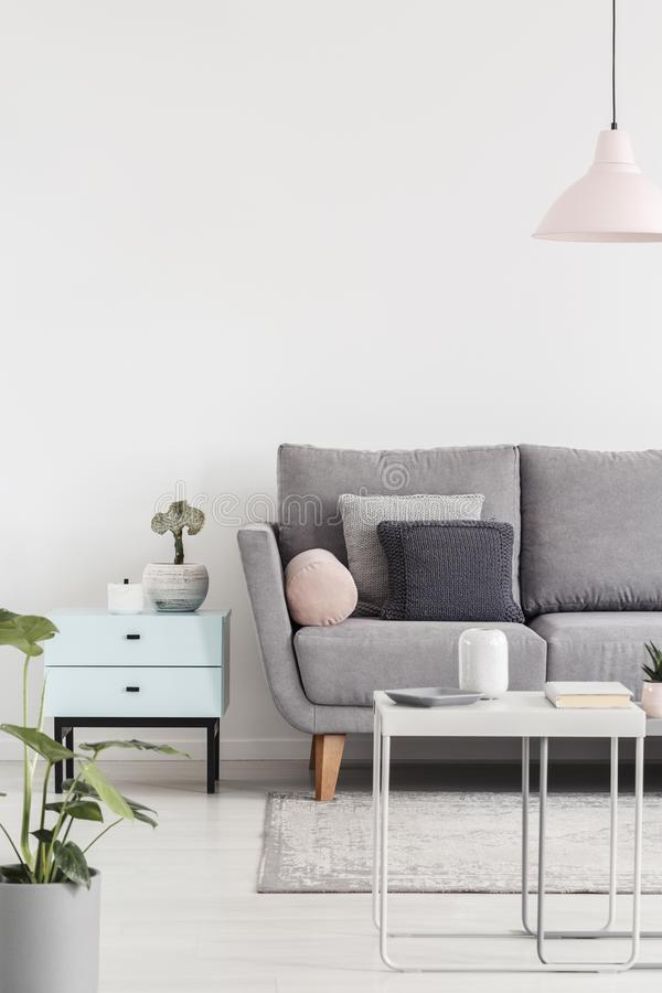 Cropped photo of a sofa next to small cabinet and coffee table i royalty free stock photos