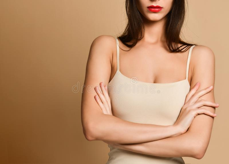 Picture of angry young woman standing over nude background. Looking camera. stock photos