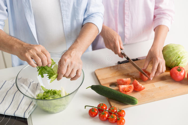 Cropped picture of mature loving couple family cooking. royalty free stock photos