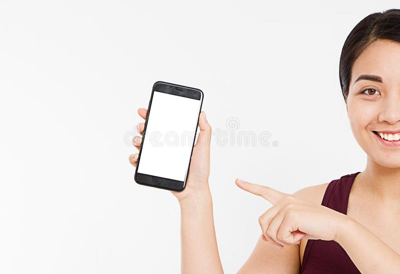 Cropped portrait asian,korean woman,girl hold blank screen cellphone, finger pointing isolated on white background, hand royalty free stock photo