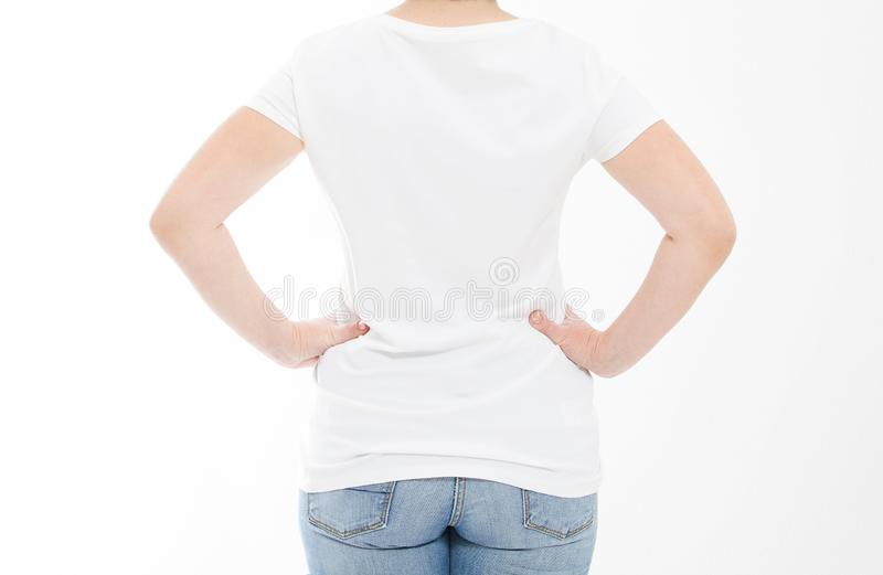 Cropped portrait back view middle age woman in tshirt on white background. Mock up for design. Copy space. Template. Blank stock photo